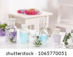 bottles with different perfume... | Shutterstock . vector #1065770051