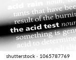 Small photo of the acid test word in a dictionary. the acid test concept.