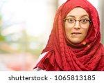 young arab woman wearing hijab... | Shutterstock . vector #1065813185