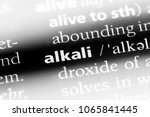 Small photo of alkali word in a dictionary. alkali concept.