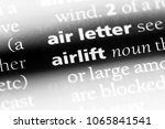 Small photo of airlift word in a dictionary. airlift concept.