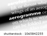 Small photo of aerogramme word in a dictionary. aerogramme concept.