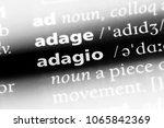 Small photo of adagio word in a dictionary. adagio concept.
