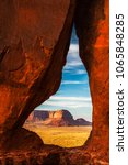 Small photo of The Eagle Mesa seen through the Teardrop Arch in Monument Valley Navajo Tribal Park at sunset with beautiful and vibrant colors.