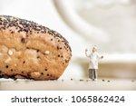 heerful baker standing near... | Shutterstock . vector #1065862424