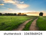 sunset above the road in the... | Shutterstock . vector #1065868424
