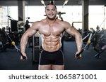 brutal strong bodybuilder... | Shutterstock . vector #1065871001