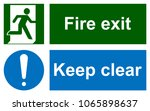 green emergency exit sign on... | Shutterstock . vector #1065898637