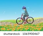 a girl with a helmet ride a... | Shutterstock .eps vector #1065900467