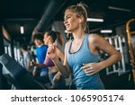 young people running on a... | Shutterstock . vector #1065905174