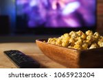 a wooden bowl of popcorn and... | Shutterstock . vector #1065923204