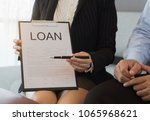 the bank officer handed the pen ...   Shutterstock . vector #1065968621