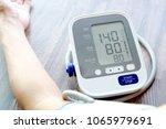human check blood pressure... | Shutterstock . vector #1065979691