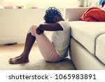 black girl with sadness emotion | Shutterstock . vector #1065983891