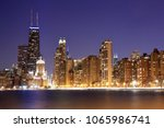 view of chicago at dusk. ... | Shutterstock . vector #1065986741