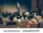 rear side of audiences sitting... | Shutterstock . vector #1066001099