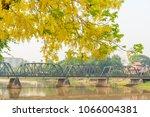 golden shower tree over iron...   Shutterstock . vector #1066004381