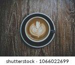 closeup latte art of coffee... | Shutterstock . vector #1066022699