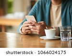 man reading news on his phone... | Shutterstock . vector #1066024175