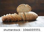 chopped fresh bread on wooden... | Shutterstock . vector #1066035551