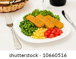 Fish dinner with vegetables at restaurant - stock photo