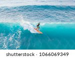 surfer at the top of the wave ... | Shutterstock . vector #1066069349