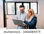 young business man holding a... | Shutterstock . vector #1066084475
