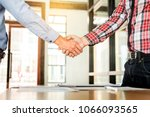 two confident business man... | Shutterstock . vector #1066093565