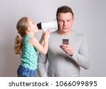 father using smartphone... | Shutterstock . vector #1066099895