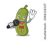 singing pickle mascot cartoon... | Shutterstock .eps vector #1066116137