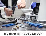 plumber at work in a bathroom ... | Shutterstock . vector #1066126037