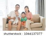 portrait of happy asian family... | Shutterstock . vector #1066137377