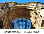 Vittorio Emanuele II Gallery, main entrance arch in Duomo cathedral square, Milan, Lombardy, Italy - stock photo