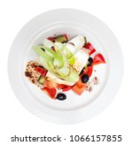 greek salad isolated top view.... | Shutterstock . vector #1066157855
