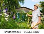 Senior Man Watering The Garden...