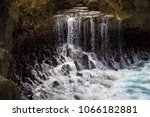 falling water on the shore ... | Shutterstock . vector #1066182881