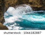 splashing wave on the shore ... | Shutterstock . vector #1066182887