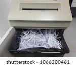document shredder with shredded ... | Shutterstock . vector #1066200461