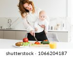close up photo of young mother... | Shutterstock . vector #1066204187