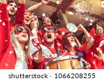 group of fans dressed in red... | Shutterstock . vector #1066208255