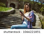 happy mid adult woman is...   Shutterstock . vector #1066221851