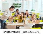 Stock photo high school students at school cafeteria 1066233671