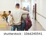 back view of teenage students... | Shutterstock . vector #1066240541