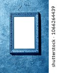 blank blue frame hanging on a... | Shutterstock . vector #1066264439