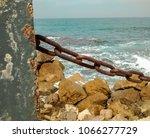 Blue Rusty Metal Pole And Chai...