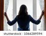 silhouette of a young woman... | Shutterstock . vector #1066289594