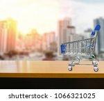 miniature shopping cart on wood ...   Shutterstock . vector #1066321025