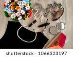 pearl beads on a black dress.... | Shutterstock . vector #1066323197