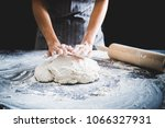making dough by female hands at ... | Shutterstock . vector #1066327931