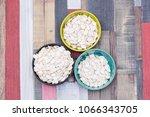 pumpkin seeds in colored bowls... | Shutterstock . vector #1066343705